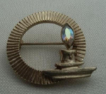 Click here to enlarge image and see more about item W58: CANDLE BROOCH