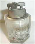 Click to view larger image of SMC LUCITE OCTAGON SNAIL & SEAHORSE  LIGHTER (Image1)