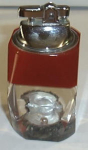 Click here to enlarge image and see more about item W85: LUCITE TABLE LIGHTER PEARL IN A SHELL