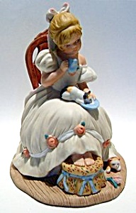 Girl milking the cat ceramic figurine (Image1)