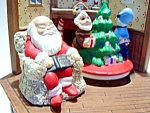 Click here to enlarge image and see more about item chr1: Vintage musical Christmas scene and Santa figurine
