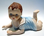 Vintage style baby on tummy ceramic figurine