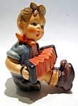 Click here to enlarge image and see more about item fighumboypl: Hummel figurine boy playing concertina