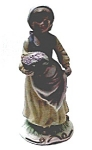 Click here to enlarge image and see more about item fpg11: Vintage girl with basket figurine