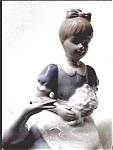 Vintage girl with swan figurine