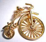 Click here to enlarge image and see more about item jcbcyclebr1: Vintage bicycle gold tone brooch or pin