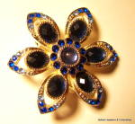 Click here to enlarge image and see more about item jcbrchblrh4: Blue rhinestone flower design vintage brooch or pin