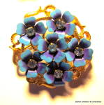 Click here to enlarge image and see more about item jcbrchblrhnml5: Avon flower rhinestone enamel vintage brooch or pin