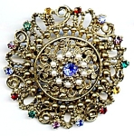 Gold plated round filigree rhinestone brooch or pin