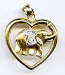 Click here to enlarge image and see more about item jfhrt5: 14k good luck elephant with trunk up pendant