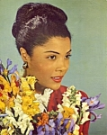 Click here to enlarge image and see more about item mb4: 1950s calendar print woman with flowers