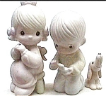 Click here to enlarge image and see more about item pm1: Precious Moments 'With This Ring' boy girl figurine