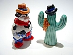Click here to enlarge image and see more about item sps22cowcac: Cowboy bull cactus Russ Berrie salt and pepper shakers