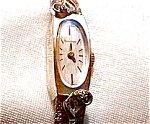 Click here to enlarge image and see more about item ww6: Vintage 14K gold Bulova diamond lady's mechanical watch