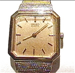 Click here to enlarge image and see more about item wwlsq10: Vintage Seiko brushed gold lady's quartz wrist watch