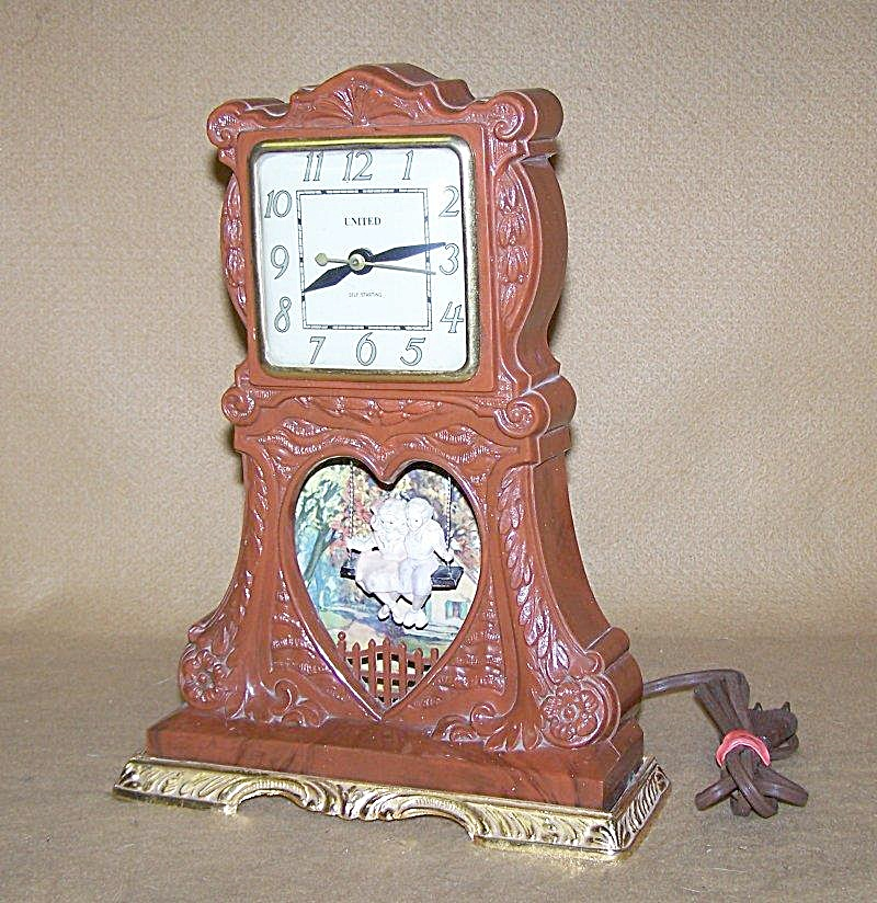 1950's United Boy-girl In Swing Music Box Clock
