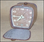Click here to enlarge image and see more about item 1240: 1950's Vintage GE Telechron Leather Cased Travel Alarm