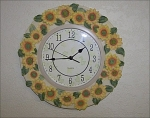 Click here to enlarge image and see more about item 1666: Unique Sunflower Wall Clock