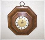 Click here to enlarge image and see more about item 1774: Burlwood Style Eight Sided Wood Wall Clock