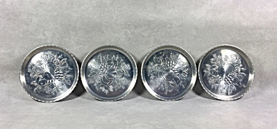 Set of 4 Midcentury Stamped aluminum Fruit & Flowers coasters (Image1)