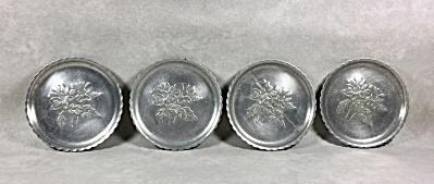 Set of 4 vintage stamped aluminum 3 3/8 inch wide coasters (Image1)