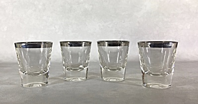 Set of four 2 1/4 inch silver rimmed Midcentury shot glasses (Image1)