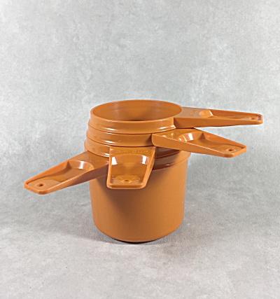 Tupperware signed set of 4 orange stackable 1970s measuring cups  (Image1)