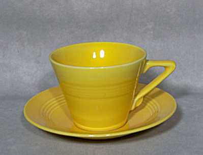 Homer Laughlin Harlequin yellow cup & saucer (Image1)