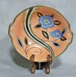 This is a great pattern in Noritake design. It is called 'speed line' by Noritake collectors. What is also desirable about this 2 cut-out tab handled bowl is the use of gold luster on the speed lines in addition to the black and white used. Black and gold leaves surround a high abstracted blue flower on one side of the asymmetrically arranged design. Pure Art Deco Noritake genius carrying a red wreath mark from the 1925-1931 period.      In excellent condition, add it to your Noritake Art Deco collection today. I am a long time member of the <a href='http://www.noritakecollectors.com'>Noritake Collectors Society.</a> Come read about our great club,  our newsletter and consider joining us in our appreciation and pursuit of Noritake!