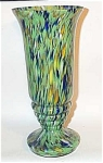 This stunning Czech furnace decorated glass Deco vase stands a little over 11 inches tall. The top opening measures a little over 5 inches. It has a great Deco shape with the stepped glass ringed base. Not signed but classic Czech Deco glass work. Excellent condition.