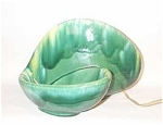 green drip biomorphic 'shell' with lamp behind shell, excellent condition, maker unknown but shown in  TV lamp book., excellent condition.