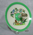 This Noritake Art Deco 5 1/4' lemon server has a gold handle with some wear to the gold and a very interesting design.  Highly stylized, the orange tulip shape, black/orange hyacinth, black and yellow leaves and the purple blue blossom combine with the mint green outer band to make it a very pleasing Deco combo! 