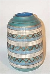 This great example of Aldo Londi designed Bitossi Mid Century Italian pottery is signed on the white base ITALY and 30/2-A.  Horizontal bands of turquoise, white, gold triangles over teal are criss-crossed by vertically sgrafitto incised lines. It's a great Eames era 1950s - 1960s look. The inside is glazed in a beautiful robin egg blue glaze.  