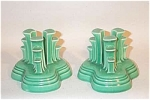 Pair of vintage Fiesta light green tripod candleholders. As the  book put out by the Homer Laughlin China Collectors Association explains on page 64-65, these were only produced from November 1935 to late 1942. They are a prized addition to any Fiesta collection. Excellent condition.