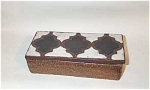 This Raymor Turkish tile top cigarette box has a design done in colors of white and black over a rough textured brown earthen body. The bottom is signed with Italy in black and TWO Raymor labels, as well as a price tag of 8575F, which I believe to be in francs, meaning the piece was at one time sold in France.  Excellent condition.