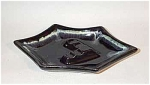 This Royal Haeger #138 Ebony Cascade 1954 ashtray has 4 rests and is fully signed on the bottom. Great 'V' shaped center which adds to the geometric look. Part of the 'new' Cascade glazes Haeger debuted as part of their 1954 line.  Excellent condition. Would look stunning on a blond wood coffee table.