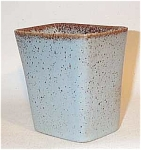 Produced by Vermont Mid-Century studio potter Stanley Ballard, a student of Glidden Parker at Alfred University in the 1940s who worked in the Burlington area,  this 4 inch tall #20 shape vase is from his early studio period as it has a heavily mottled blue overglaze and a deep chocolate underglaze which can be clearly seen on the interior of the piece. A recessed base is another early feature as well as the long trailing tail of the letter d of the word Ballard. Excellent condition