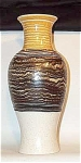 Produced by Royal Haeger in the late 1960s, in colors of yellow, white, brown and black, this #4170 shape vase is from the Smoke Ring line. Excellent condtion. It carries the original gold foil Royal Haeger label as well.