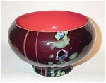 This Czech Deco red black glass millefiori bowl is 5' tall, 7' dia red lined black glass with cane millefiori..and 4 red applied pulled lines.  There is one very small rim chip which only does not even go through the inside red glass layer. Otherwise, it is in excellent condition. It is signed with the block letter acid mark Czechoslovakia in a semi circle letter arrangement. Hard to find!
