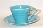 One of the more Art Deco shapes in Homer Laughlin's Harlequin line is the cup and saucer due to the sharply angled handle and three speed lines.  