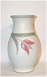 "Done by Lincoln Vermont potter Marcy Mayforth, this1988 8 3/4"" pink tulip vase is glazed in a celadon green inside. The design is done in the sgraffito technique, then fill in as in an enamel piece. There are three pink and blue tulips blossoms on the piece, which is signed Mayforth on the bottom. It is in excellent shape."