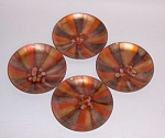 Produced by the Cheshire CT firm of Bovano (started in 1953 by John BOnsignor, Gene VAn Leight and Warren NOden), this set of 4 3 1/2 inch diameter coasters features what I have named the Orange Sunburst or Ray pattern which consists of alternating rays of  colors: orange, gold, a pinkish brown and chocolate brown coming out of a asymmetrically placed focal area of small enamel jewels in the same 4 colors. 