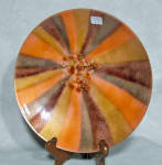 Produced by the Cheshire CT firm of Bovano (started in 1953 by John BOnsignor, Gene VAn Leight and Warren NOden), this 9 inch wide enamel bowl with a 1960s era abstract pattern features 4 colors: orange, gold, a pinkish brown and chocolate brown. I have named it Sunburst. The abstract pattern is alternating rays of these 4 colors in order. Matching colored small jewels are placed asymmetrically near the center. The back is done in the typical black counterenamel Bovano uses with remnants of the three original black felt pads still visible.  The normal gold circle label which reads Handcrafted by Bovano of Cheshire Conn is intact. It is in excellent shape with no nicks to the edge.  Add it to your Mid-Century Enamel collection today