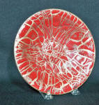 Annemarie Davidson (1920-2012) learned her enameling craft first from the great Doris Hall (1907-2001) in Cambridge, MA  in 1957. In California she continued her studies with Curtis Tann.  Her combination of geometric and organic form in her designs culminated in her most celebrated abstract designs, her Jewel line which features pieces of glass used to create free-form organic shapes which she calls Jewels. She also uses a sgraffito technique, incising straight lines from the center of her plate with the sharp point of a dart.   This 6 inch wide low bowl is unusual for its pattern. It is a very freeform mix of her usual controlled Grooveline pattern and small specks of gold on the red background.  The back of the plate is signed with her charcteristic AD interwined intiails but lacks her usual her paper label which reads Annemarie Davidson handcrafted enamels Sierra Madre California.  Every piece was handcrafted by her alone, from start to finish. It retains its original three felt pads. Excellent condition.   The work of Annemarie Davidson was included in the seminal exhibit titled Painting with Fire which opened in Jan 2007 at the Long Beach Museum of Art. She was one of 30 enamelists included with a one page entry on her life and work. Her page is page 266 of the catalogue.
