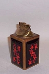 Produced by the Cheshire CT firm of Bovano (started in 1953 by John BOnsignor, Gene VAn Leight and Warren NOden), this 4 1/2 inch tall cigarette lighter features a great design. Each of the four sides has bold stylized red 4 petal flowers on a black background. This pattern is shown on page 69 of the Spring 2003 Modernism magazine in Alan Rosenberg's article on enamel.  