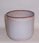 Produced by Vermont Mid-Century studio potter Stanley Ballard, a student of Glidden Parker at Alfred University in the 1940s who worked in the Burlington area,  this Ballard white mottled #91 4 3/4 inch round vase is in excellent condition. The graduated stepped base is very unusual for Ballard . I think this shape is from his later studio period.