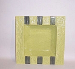 Measuring 8 1/2 inches square, this 6 rest ashtray in chartreuse green and forest green screams 1950s!  The inside of the well is done in a speckled pattern on the chartreuse and the raised border is done in a textured surface like a concrete block. The contrast between the forest green used for the rests and the rest of the ashtray is truly stiking. It is in excellent condition and would look fabulous on a glass top coffeetable or just filled with some soaps or bonbons. Add it to your collection today.