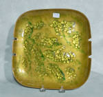 Produced by the Cheshire CT firm of Bovano (started in 1953 by John BOnsignor, Gene VAn Leight and Warren NOden), this 8 1/2 inch square 4 rest Bovano ashtray is done in a very attractive overall pattern of small gold mini-jewels in a leaf pattern with lines of green suggesting stems amongst them.  Done on a standard Bovano green background, it is a very attractive abstract pattern. On the back there are the original four black felt pads and the imprint of the original Bovano gold paper label which is missing.  It is in excellent condition. Add it to your Bovano or Mid-Century enamel collection today.