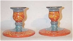 Noritake pair of orange Deco candleholders with Oriental yellow paisley-like border motif.  Excellent condition.