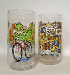 This pair of restaurant memorabilia will certainly bring back some fond memories of the 1980s.  The Great Muppet Caper was the inspiration for four glasses, two of which you have here.  One one glass, you see the Happiness Hotel, on the other specific characters as well as the McDonalds yellow logo and the Henson Associates Inc 1981 name. 